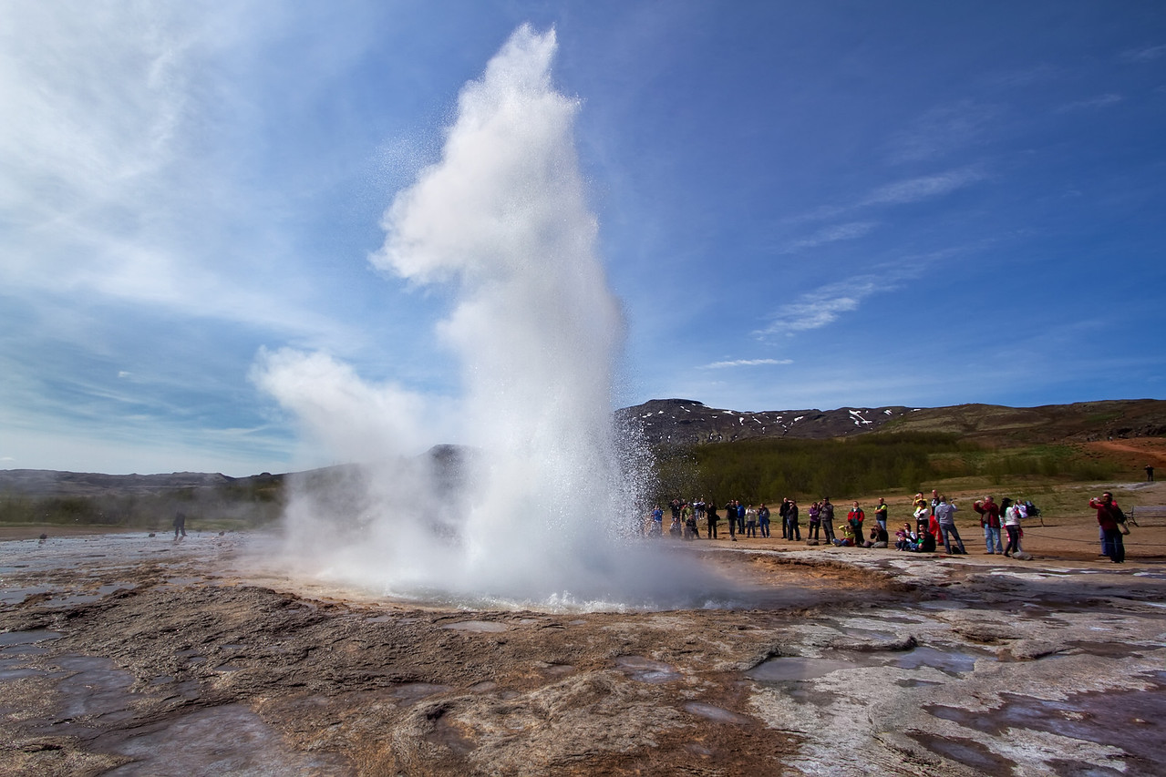 """<H3>Exhale </H3> Popular with visitors, Strokkur is one of the most reliable geysers in the world spouting off every few minutes. Its right next door to the original """"Geysir"""" after which all all geysers are named. Sadly it is not as active or powerful as it use to be (it used to shoot water up to 80m in the air!) - apparently people used to throw rocks into it to try to set it off but that clogged it up instead."""