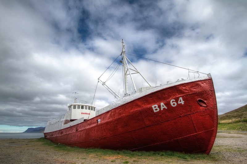 <H3> Gardar sails no more </H3> The oldest steel ship in Iceland now rests on a remote shore in the Westfjords
