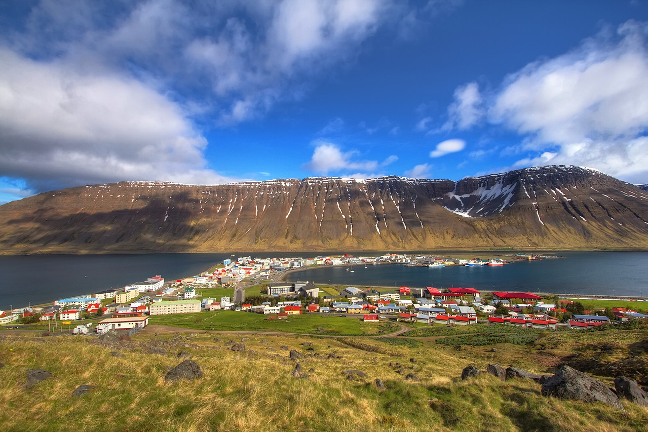 <H3> Isafjordur </H3> One of my favourite towns in Iceland - Isafjordur is a thriving community nestled in between towering mountains in the remote WestFjords region of Iceland - After driving for hours through some pretty rugged and wild terrain, it almost feels surreal to arrive at civilization here - an urban oasis!