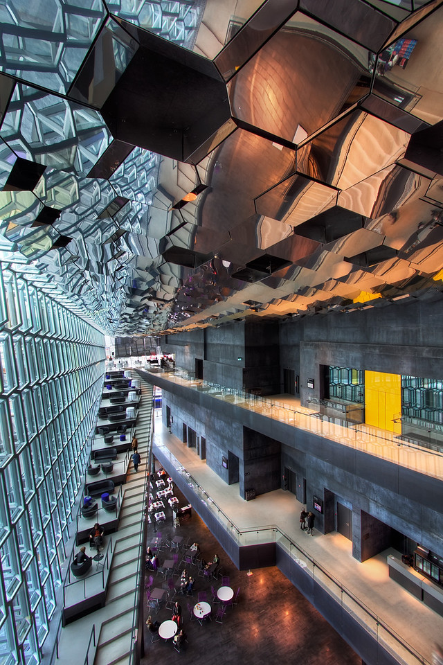 <H3> Honeycomb Reflections </H3> The state-of-the-art convention center - Harpa in Reykjavik boasts some amazing interior architecture. It mimics the naturally occuring hexagonal basalt structures found in many places accross the country.