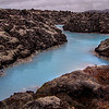 <H3>Blue Streams and Lava Fields</H3> Does a place like this really exist?? Having seen it with my own eyes, I guess I'll have to believe it. What a mind-bending place Iceland is! This is around the famous Blue Lagoon set in foreboding lava fields of Reykjanes Peninsula - the milky blue water is actually the bi-product of a geothermal power plant...some years ago, it was discovered the algae rich sea water together with mineral salts and silica mud are very good for skin, making Blue Lagoon Spa one of the biggest tourist attractions in the country