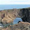 Dyrhólaey is a 120-metre high promontory,  got its name from the massive arch that the sea has eroded from the headland