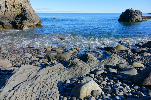 Djúpalónssandur is a sandy beach and bay on foot of Snæfellsjökull in Iceland. It was once home to sixty fishing boats and one of the most prolific fishing