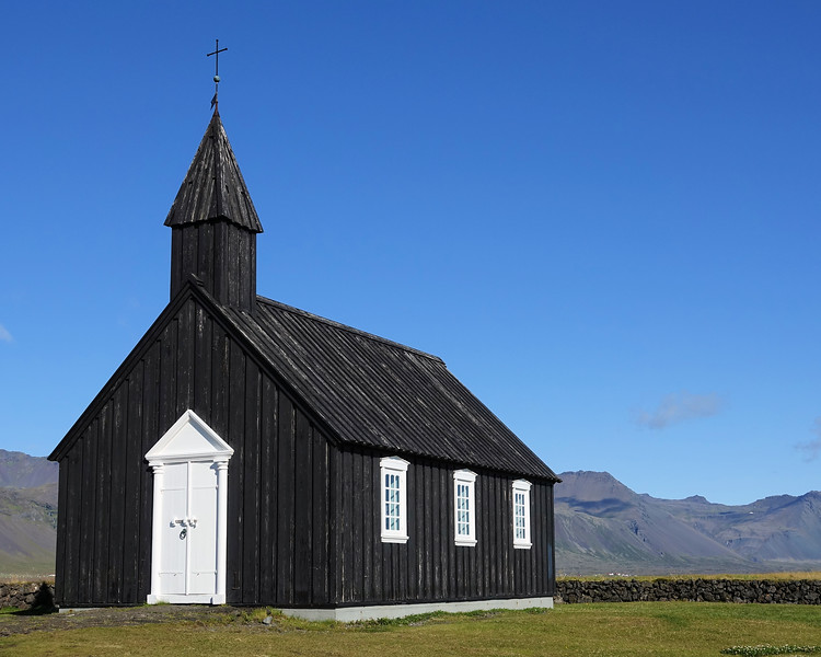 Búðakirkja - Tiny wooden church dating back to the 19th century in a scenic natural area with a lava field.