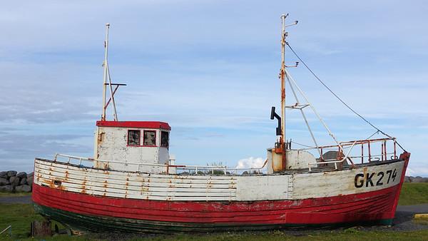 Old boat outside Garður Old Lighthouse