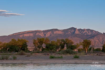 Sunset shining on mountains over the Rio Grande River in NM.