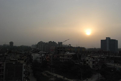 View of sunset from our apartment in Delhi