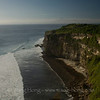 Sea cliff at Uluwatu in late afternoon.