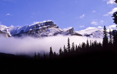 Mountain in fog  from wilcox mountain. looking west near Icefields parkway,  Alberta, Canadia. 1998