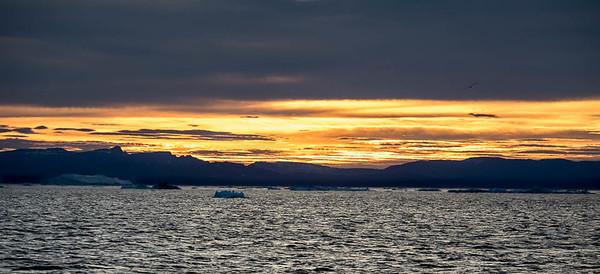 Sunset on Disko Bay, near Illulissat, Greenland.