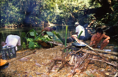 In short order, they prepaired a delicious meal, fresh from the jungle.  This was  our last day with the Iben people.  I will never forget their friendship and the experience of being with them.  Batang Ri river, Sarawak, Malaysia.  1996
