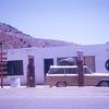 Getting has with glass bowl pump.  El Rosario, Baja california, Mexico.  1974