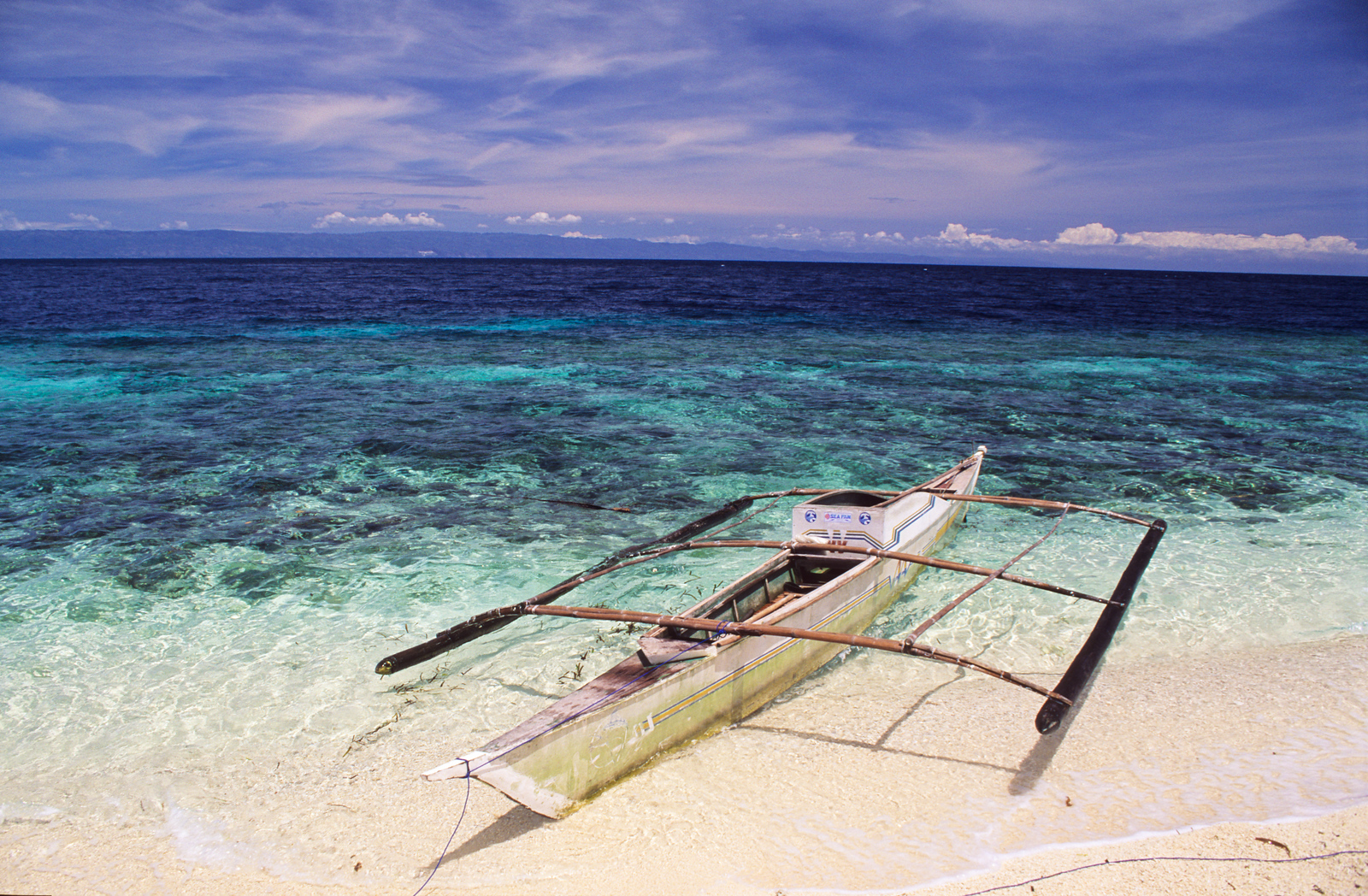 Typical fishing boat.  Balicasag island, Philippines.