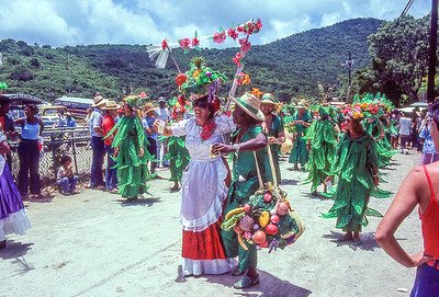 July the 3rd Parade.  In celebration of emancipation day.  Cups are full of rum for any bystander who whats it.  Cruz Bay, St. John Island, US Vergin islands.  1979