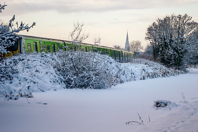 Train approaching Maynooth near the ice-covered Royal Canal