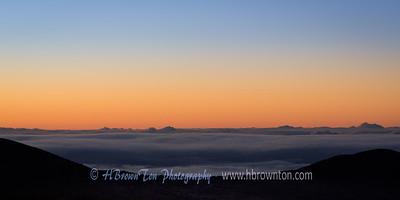 Pre-dawn Glow Above the Clouds