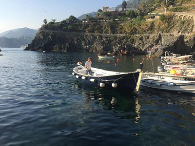 Sunset tour around Cinque Terre in old fishing boat.