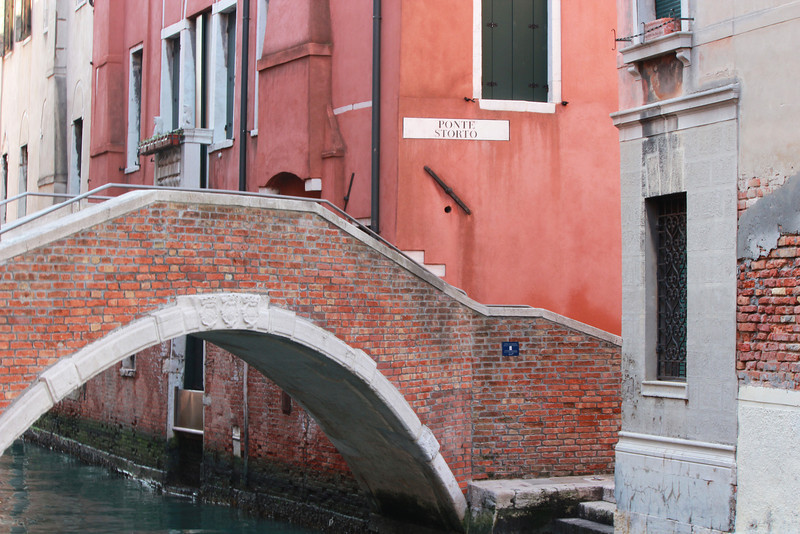 Italy, Venice, Brick Bridge crossing a Canal