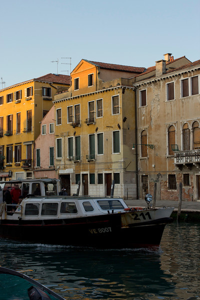 Italy, Venice, Canal with Boat and Buildings SNM