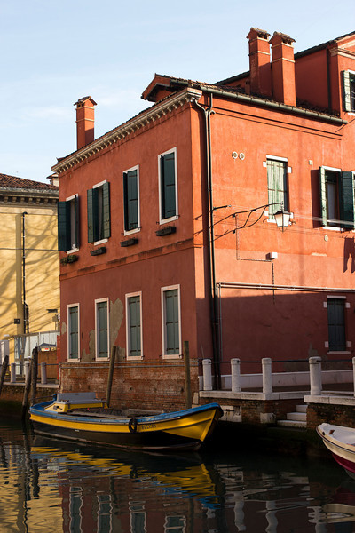 Italy, Venice, Boat and Building in Canal SNM