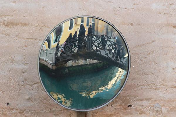 Italy, Venice, Bridge over Canal through Mirror