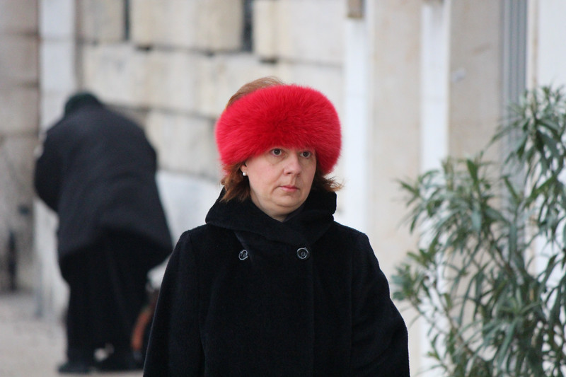Italy, Verona, Lady with Bright Red Fluffy Hat