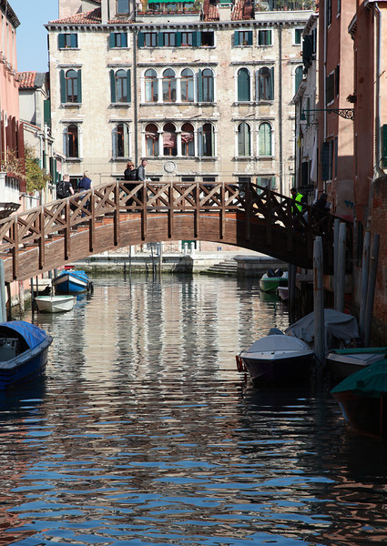 A wooden bridge over a canal in Venice, Italy