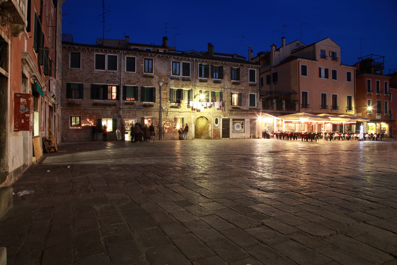A square in Venice at night