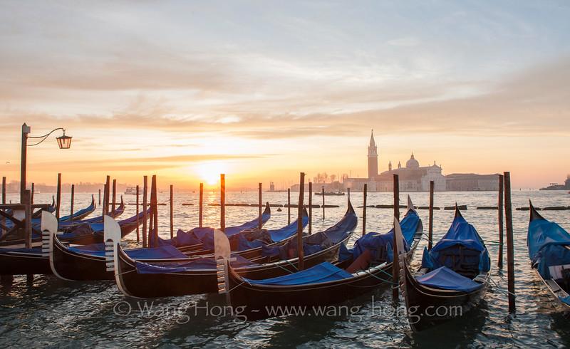 Looking to the Church of San Giorgio Maggiore over gondolas from Piazza San Marco at sun rise, Venice (Jan. 2015)