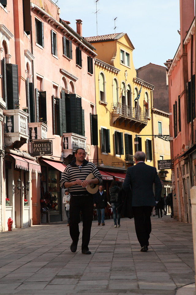 Gondolier walking in Venice