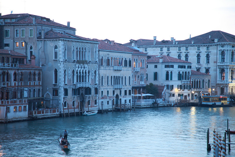 A lone gondolier makes his way along the Canal Grande, or Grand Canal, Venice, in the early evening.