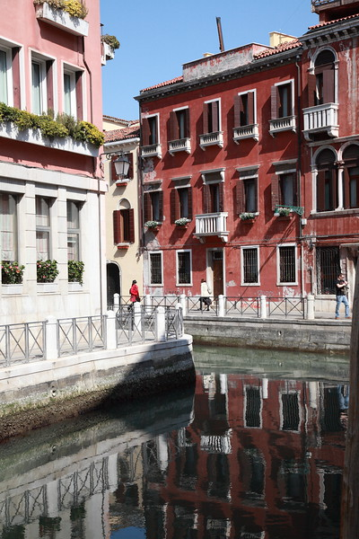 Buildings reflected in a canal, Venice, Italy