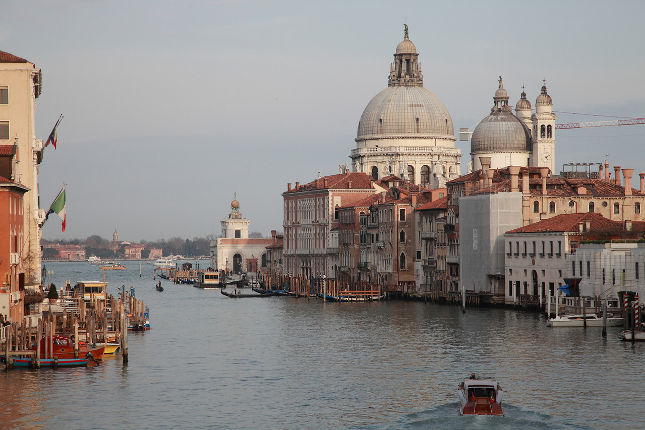 Canal Grande, Venice. The dome of the Basilica of Santa Maria della Salute towers above the buildings.