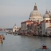 Canal Grande, Venice. The dome of the Basilica of Santa Maria della Salute towers above the buildings.