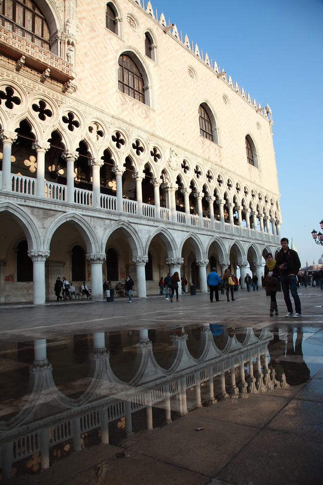 Doge's Palace, St Mark's Square, Venice, Italy, reflected in the water on the square