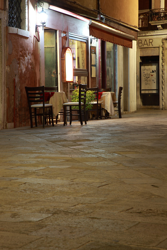 Tables and chairs set outside a restaurant in Venice, Italy