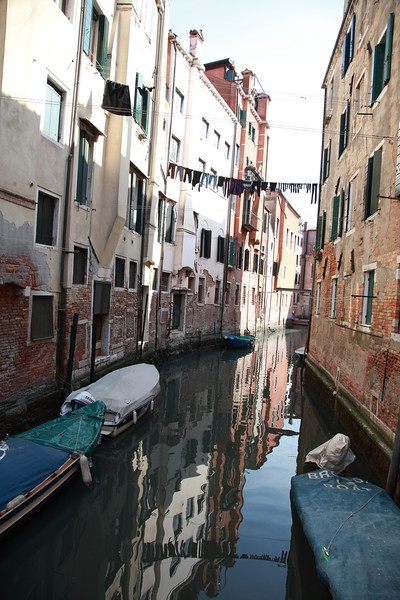 Laundry strung between buildings, across a canal, Venice, Italy