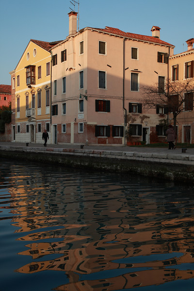 Buildings in Venice reflected in the water of a canal