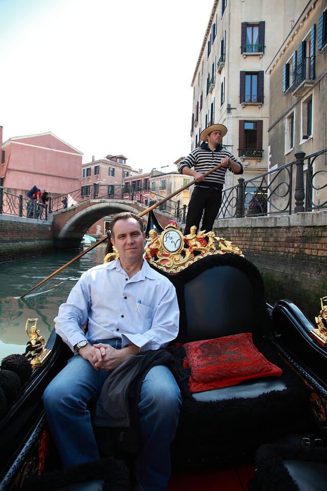 Tourist in a gondola, Venice, Italy