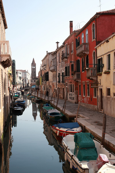 A row of boats moored in a canal, Venice, Italy.