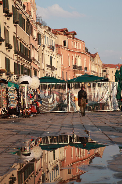 Buildings reflected in a puddle after the rain, Venice, Italy