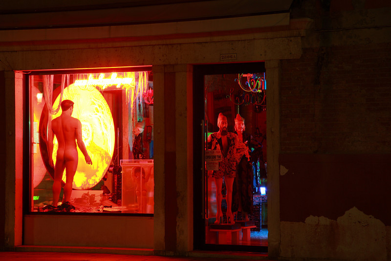 A shop window on a Venice piazza at night