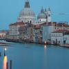 Canal Grande, Venice, in the early evening. The dome of the basilica of Santa Maria della Salute towers above the buildings.
