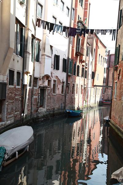 Laundry hanging between buildings in Venice