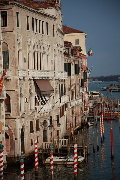 Venice buildings, leaning slightly, with gondola mooring poles