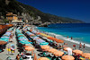 Colorful beach umbrellas at Cinque Terra - Monterosso, Italy