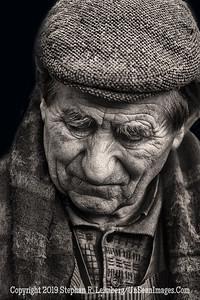 Man in Rome Facing Down - Copyright 2015 Steve Leimberg - UnSeenImages Com