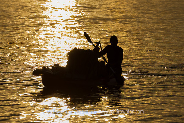 Local merchant paddling to market