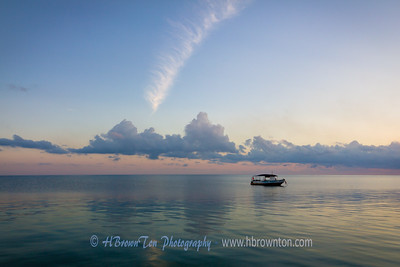Feather in the sky -- early dawn over Carribean Sea, Jamaica