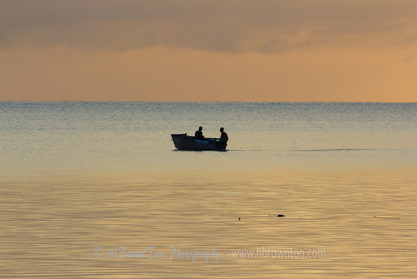 Fisherman out to sea in early dawn.